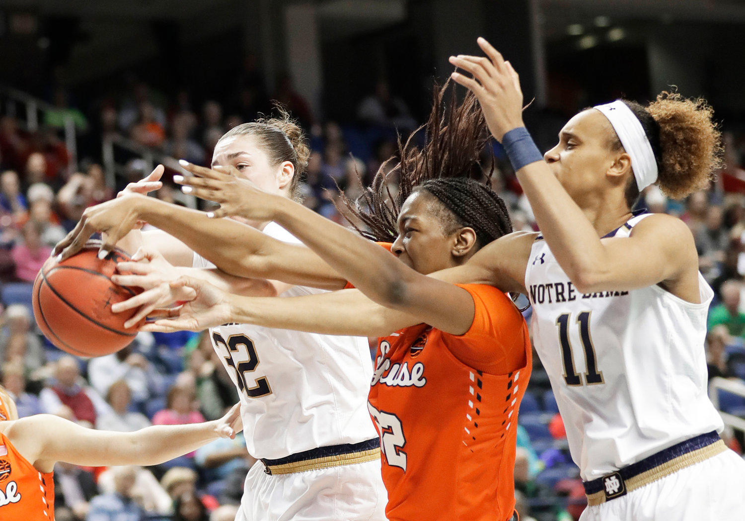ALL ARMS — Syracuse's Amaya Finklea-Guity, middle, battles Notre Dame's Brianna Turner, right, and Jessica Shepard for a rebound during the second half of Saturday's ACC Tournament semifinal game in Greensboro, N.C. Notre Dame breezed to a 91-66 win.