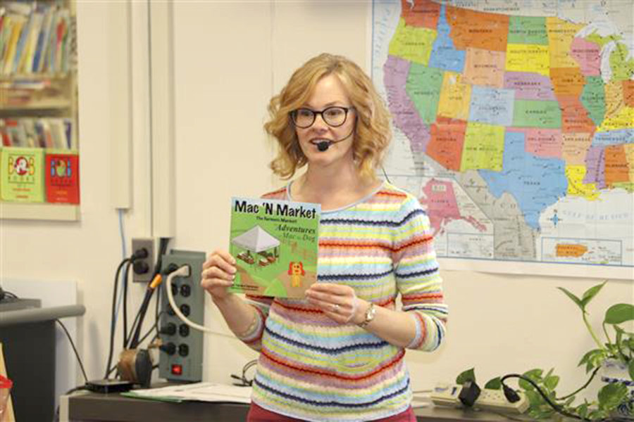 "INTRODUCING 'MAC' — Children's book author Tamara Cantarano introduces her newest book, ""Mac 'N Market"" to children at Westmoreland Primary Elementary School."