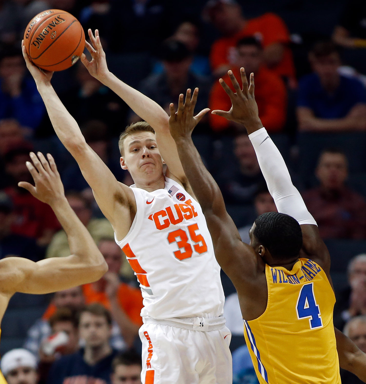 LOOKING TO PASS — Syracuse's Buddy Boeheim looks to pass the ball as Pittsburgh's Jared Wilson-Frame defends during the first half of Wednesday night's ACC Tournament second-round game in Charlotte, N.C. Boeheim had a team-high 20 points for the Orange in their 73-59 victory.