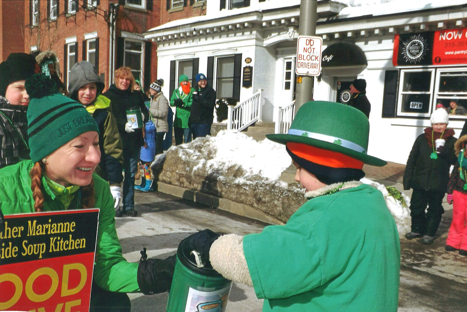 COLLECTION  — Volunteers collect donations for the Mother Marianne West Side Kitchen during last year's St. Patrick's Day parade in Utica.