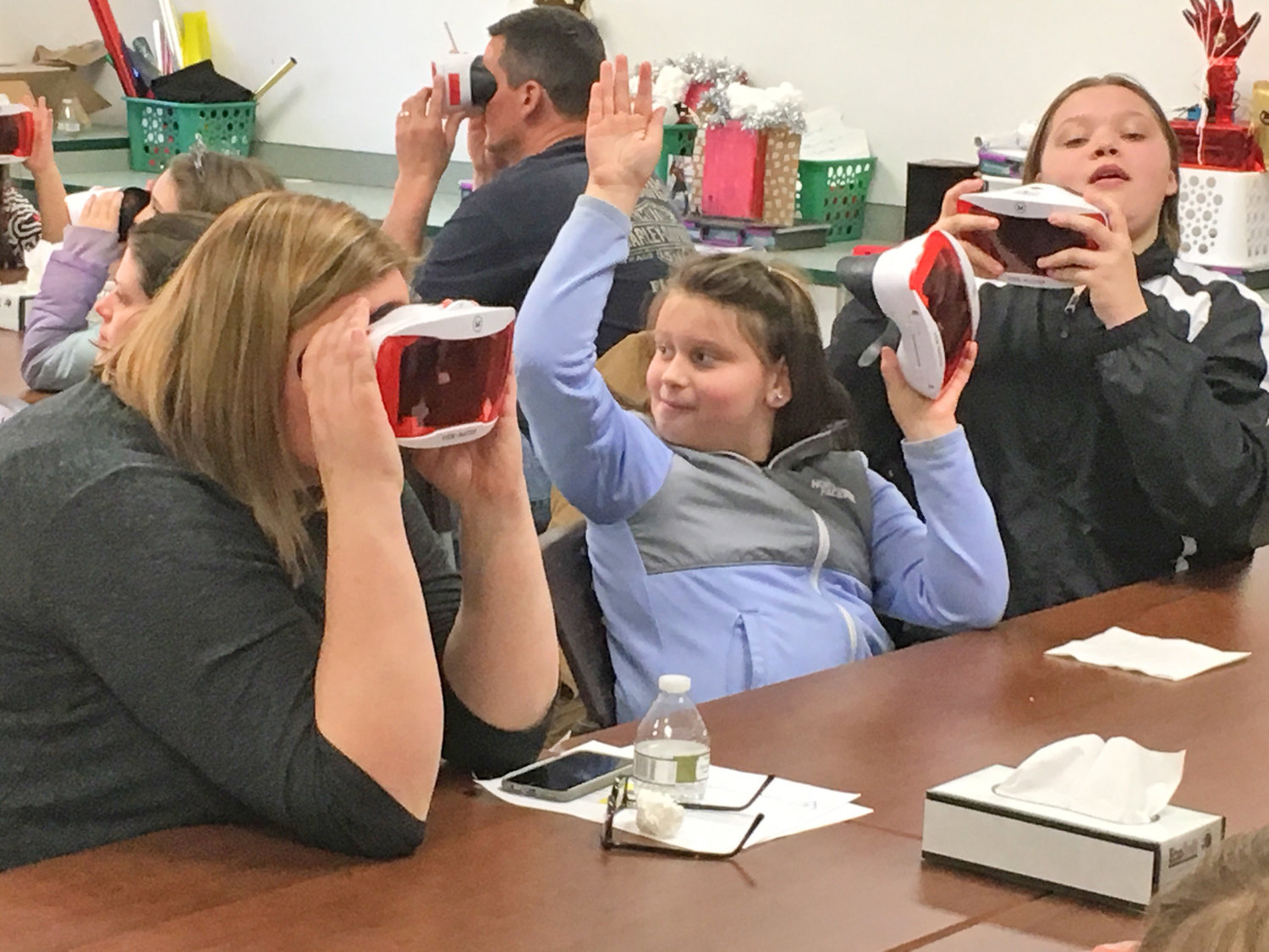 VIRTUAL REALITY TOUR — Jennifer Thurston-Brown, left, along with daughters Amber, fourth grade, and Madison, seventh grade, take turns climbing Mount Everest during the virtual reality activity at the ZI3 STEAM Adventure Night.