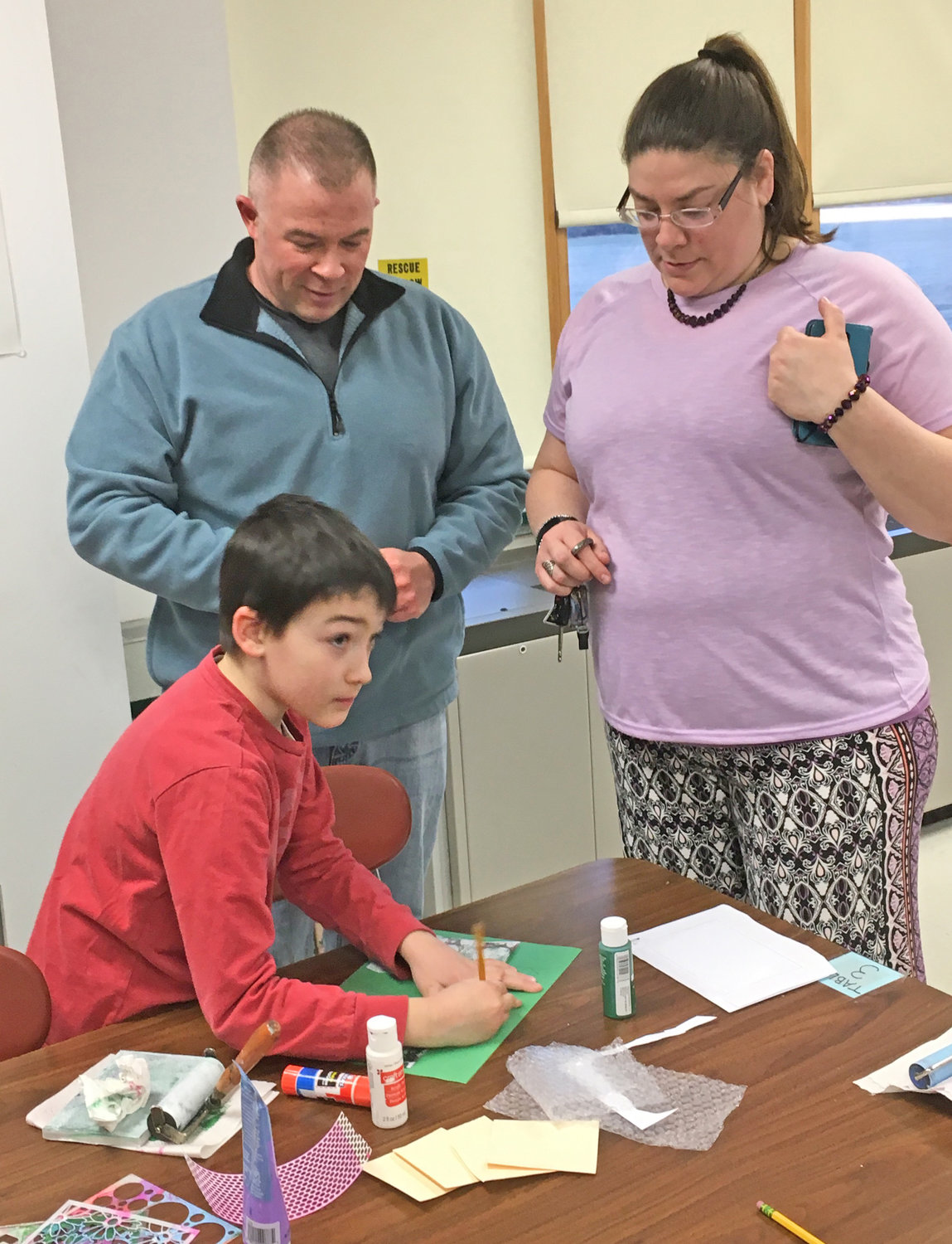 FAMILY FUN — Jim and Angela Hayes, along with son Keegan, third grade, learn the art of printmaking together at Westmoreland Upper Elementary School's XI3 STEAM Adventure Night.