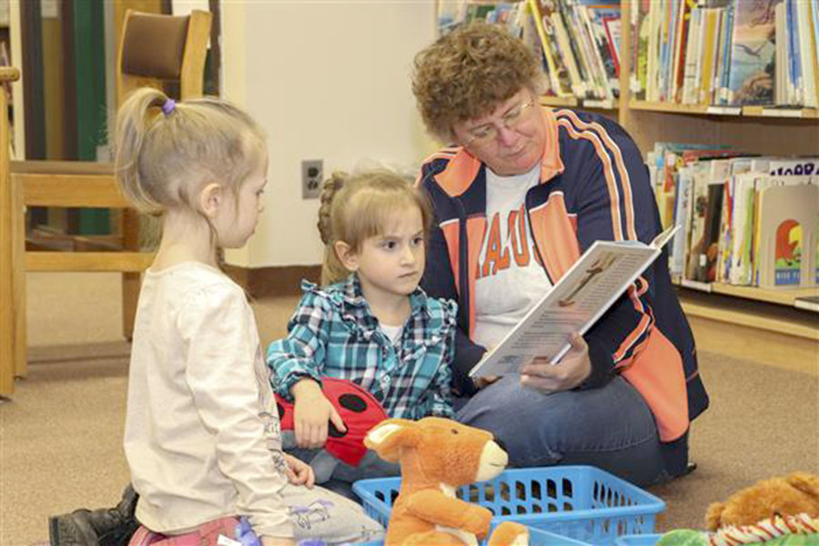 READING TIME — Children watch and listen as a volunteer reads them a story during Westmoreland Central School's Literacy Night.
