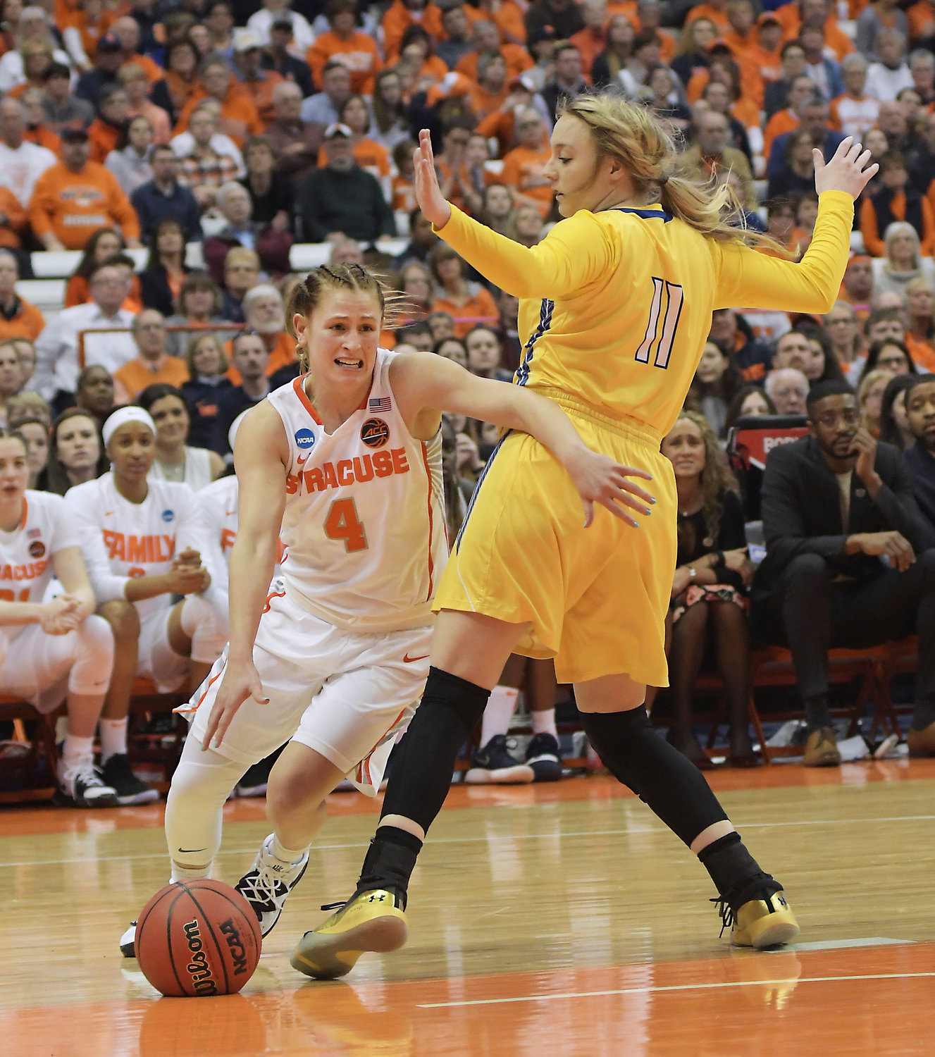 COMING BACK — Syracuse's Tiana Mangakahia, shown driving against South Dakota State's Madison Guebert during an NCAA Tournament second-round game on March 25, has announced that she will return for her final year of eligibility after considering making herself eligible for the 2019 WNBA draft.