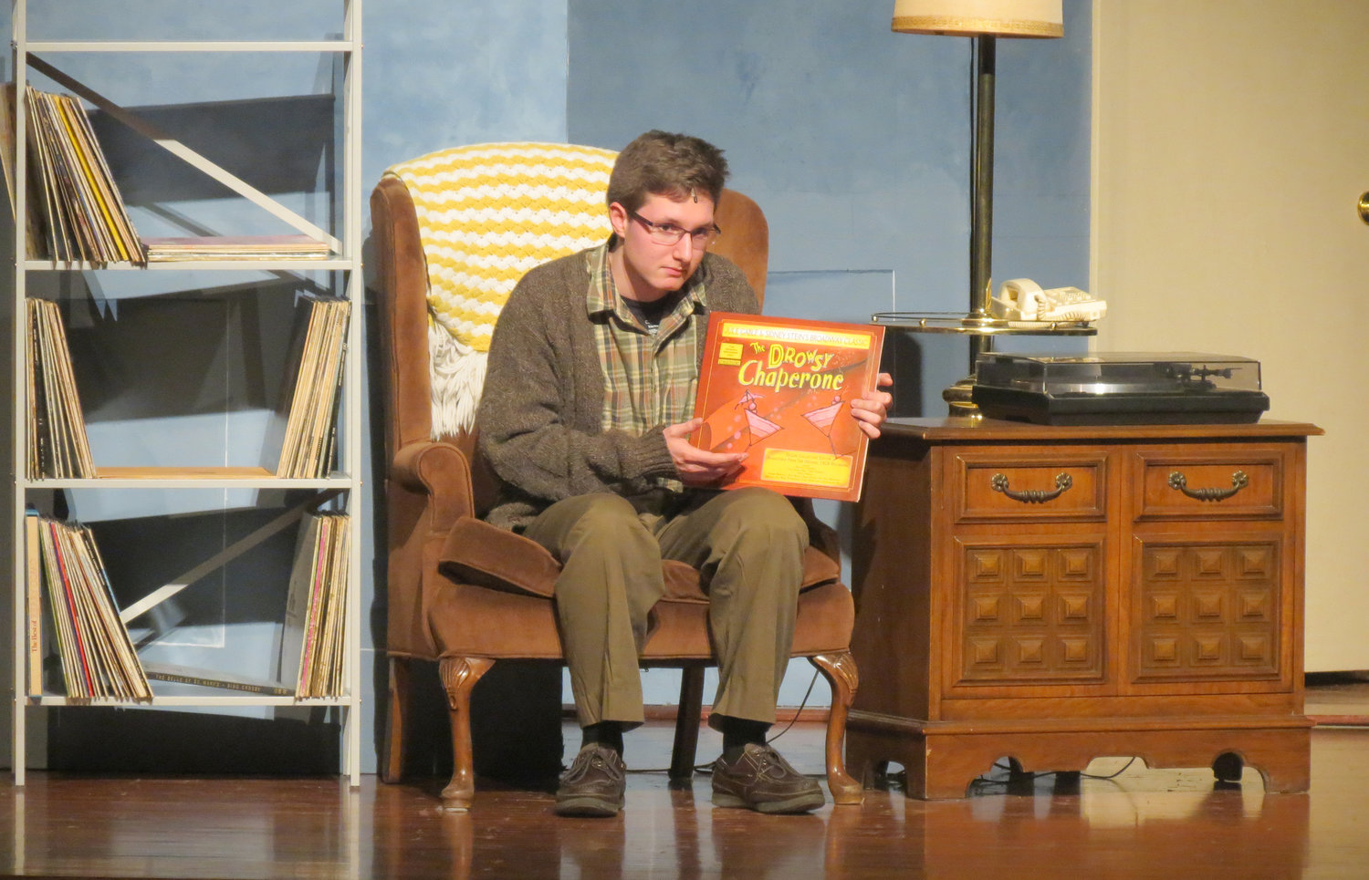 "SEATED FOR THE SHOW — Connor Evans, as Man in Chair, is among cast members for the Rome Free Academy Musical presentation of ""The Drowsy Chaperone."" Performances will be Thursday, Friday and Saturday at 7:30 p.m. in the RFA auditorium."