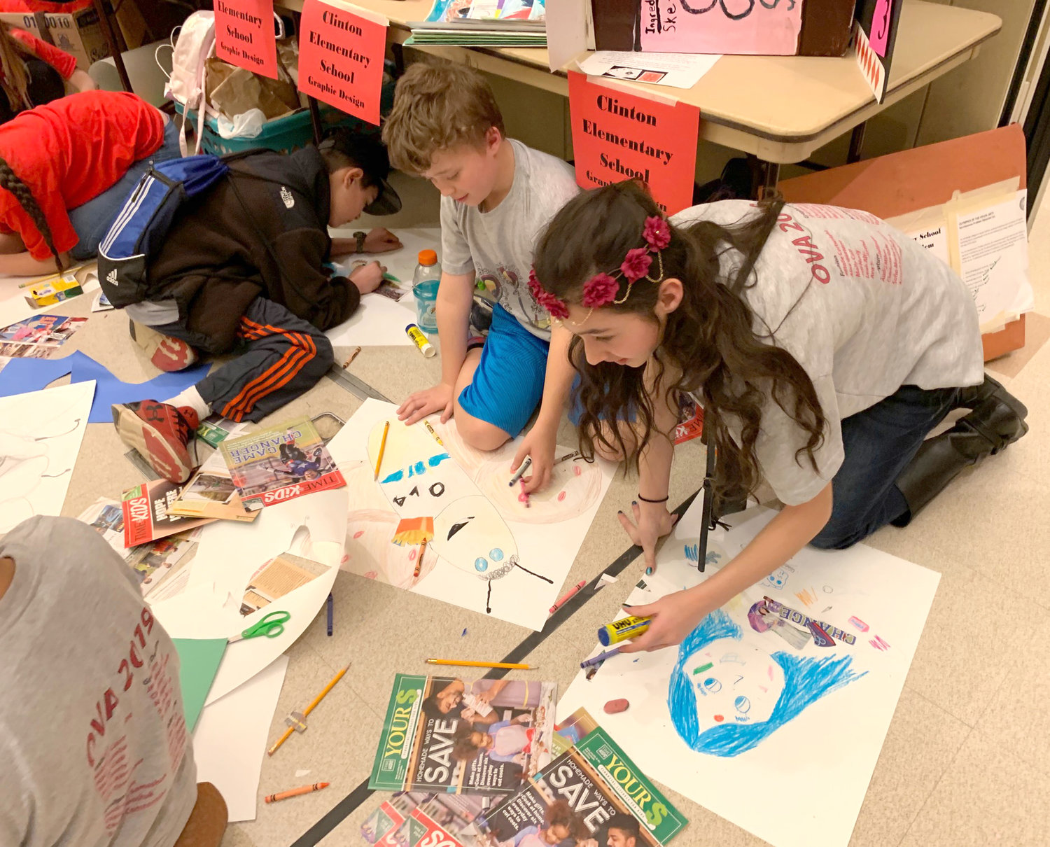 GRAPHIC DESIGNERS — Young graphic designers from Clinton Elementary School work away at their projects during the 37th annual Olympics of the Visual Arts hosted by the state Arts Association in Saratoga Springs.