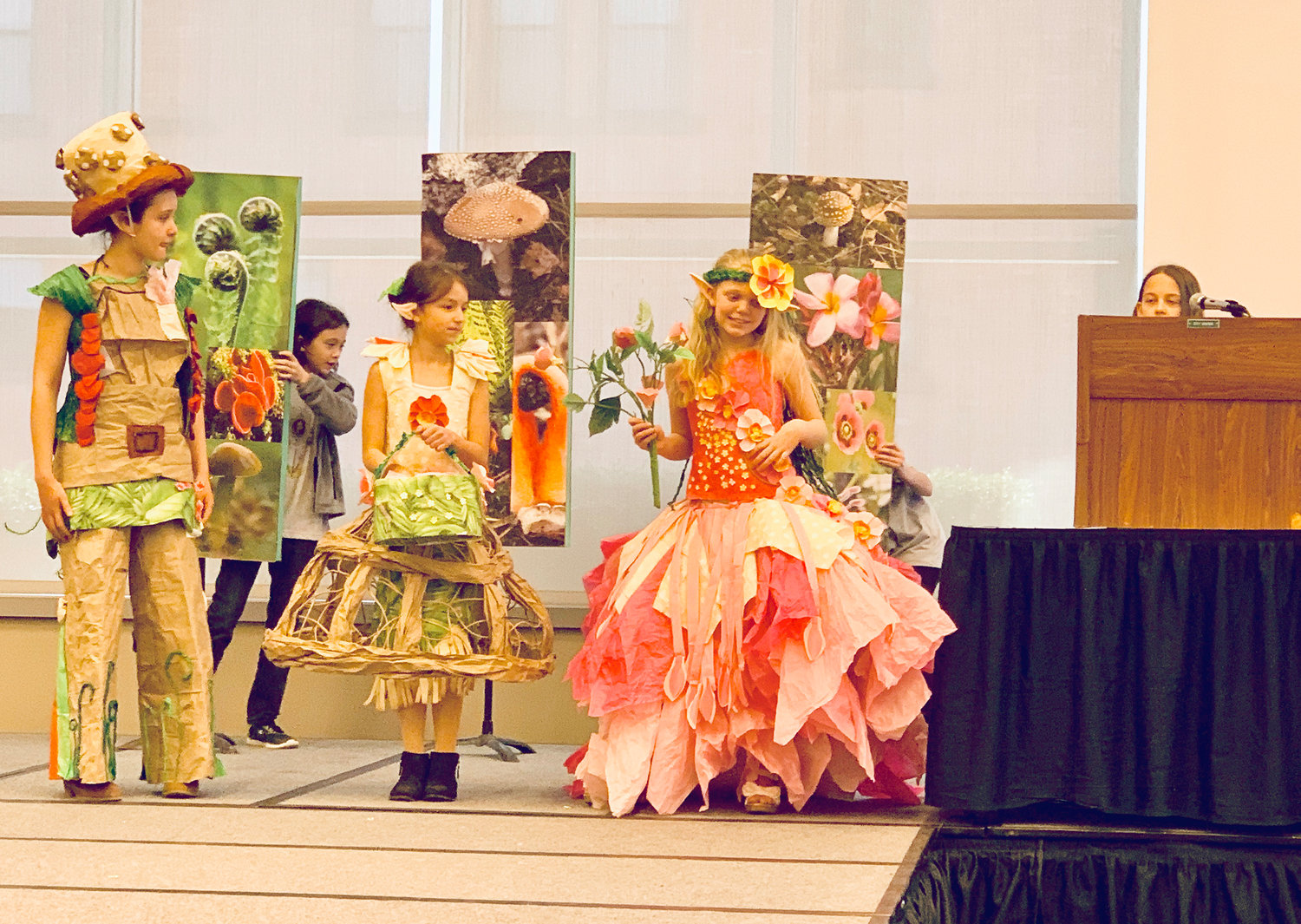 RUNWAY READY — Small fairies from Clinton Elementary School model their paper creations at the Olympics of the Visual Arts.  The school placed first in the category.