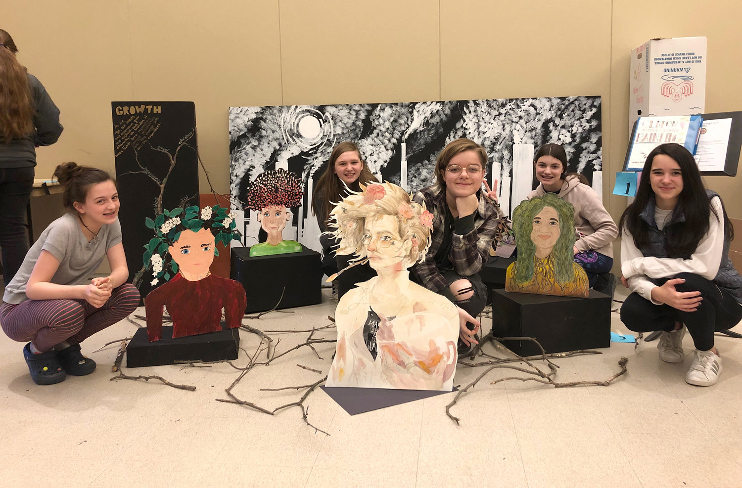 "THIS IS ME — Clinton Central School students who were part of the ""painting team"" show off their likenesses 50 years into the future at the Olympics of the Visual Arts."