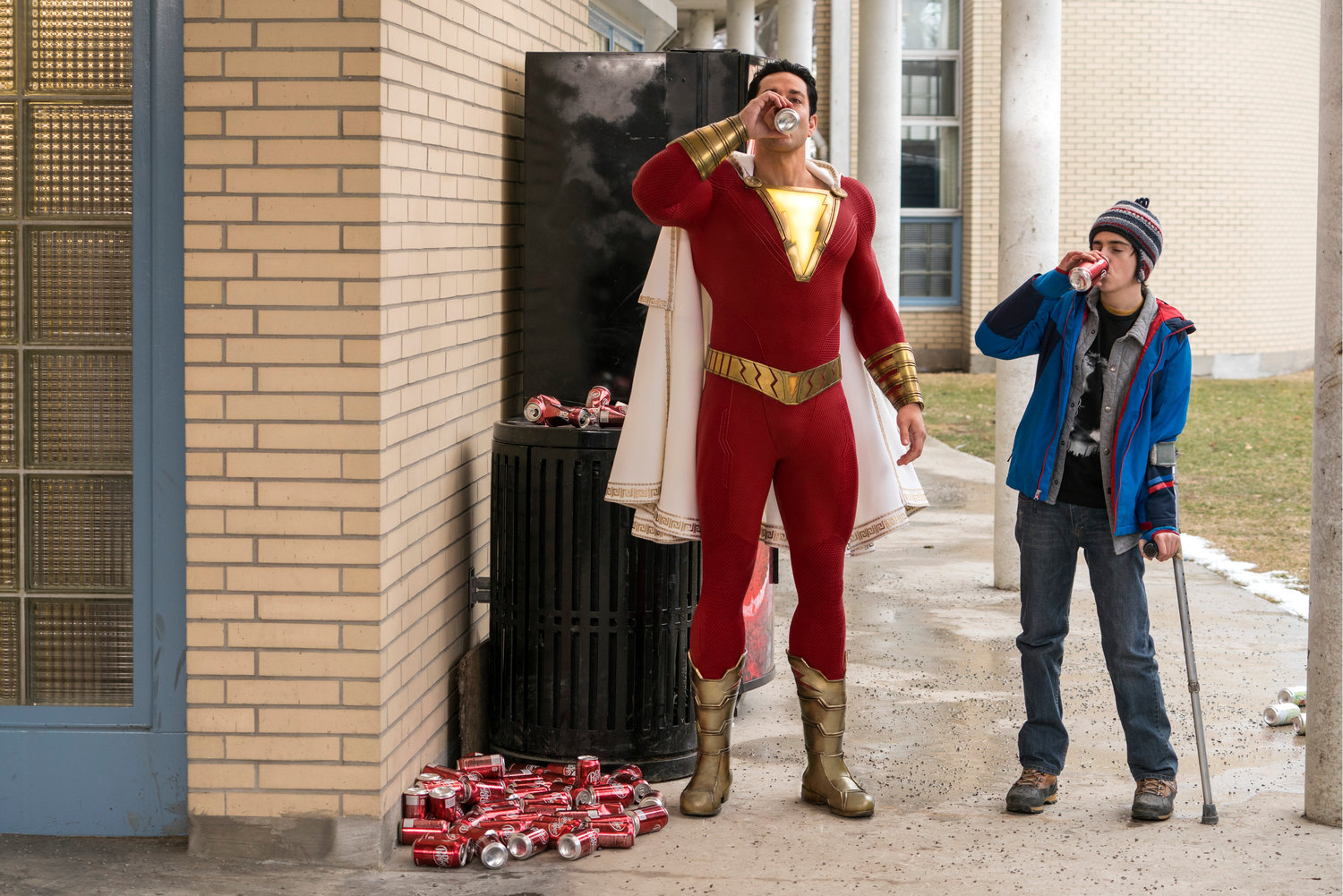 "CHILDLIKE GLEE —  Zachary Levi, left, and Jack Dylan Grazer in a scene from ""Shazam!"""