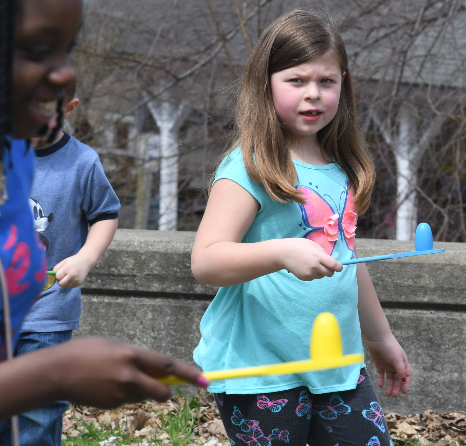 EGGED ON —Participants keep their eyes on their eggs — and the competition — during the egg and spoon race at a previous Utica Zoo Eggstravaganza. The zoo, located on Steele Hill Road, will host a series of activities as part of its holiday celebration.