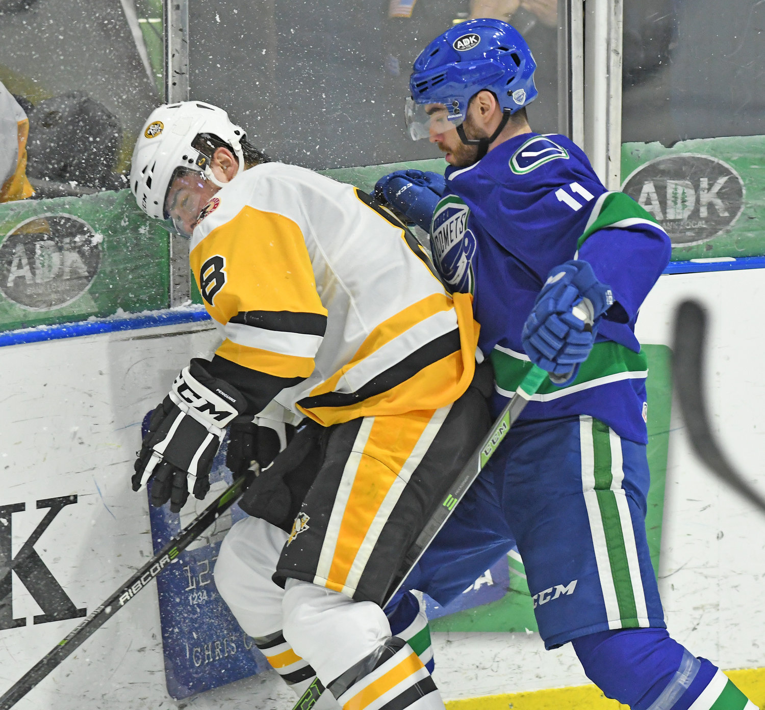 BIG HIT — Cam Darcy of the Comets crushes Wilkes-Barre/Scranton defender Michael Kim into the boards during a rough game Friday night at the Utica Aud. Darcy got into the first of seven fights in the game, an 8-1 win for the Comets.