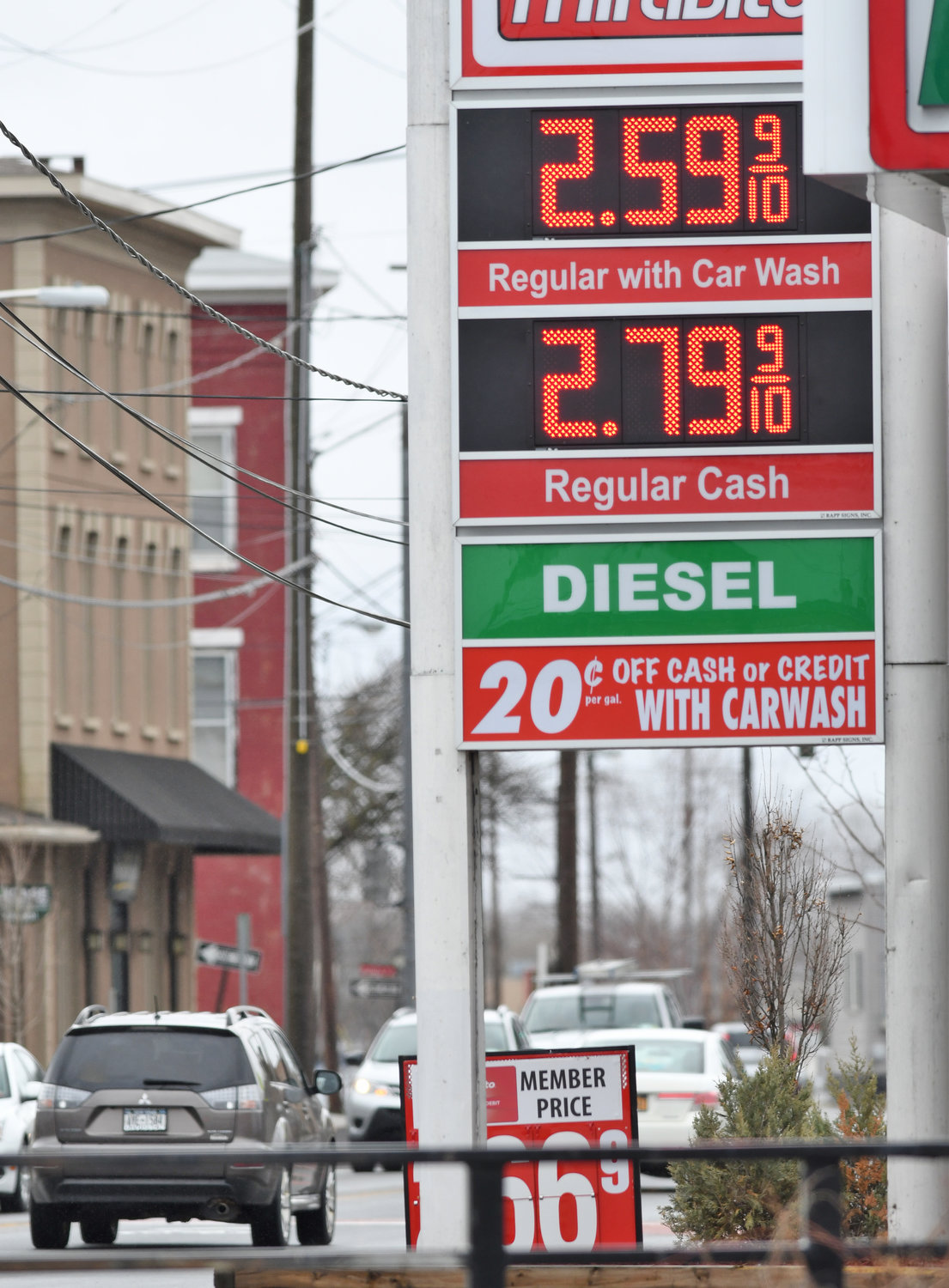 CONTINUING TO CLIMB — Gasoline prices are continuing to rise locally. Pictured is the Mirabito price tree on East Dominick Street with lunchtime traffic in the background Monday.