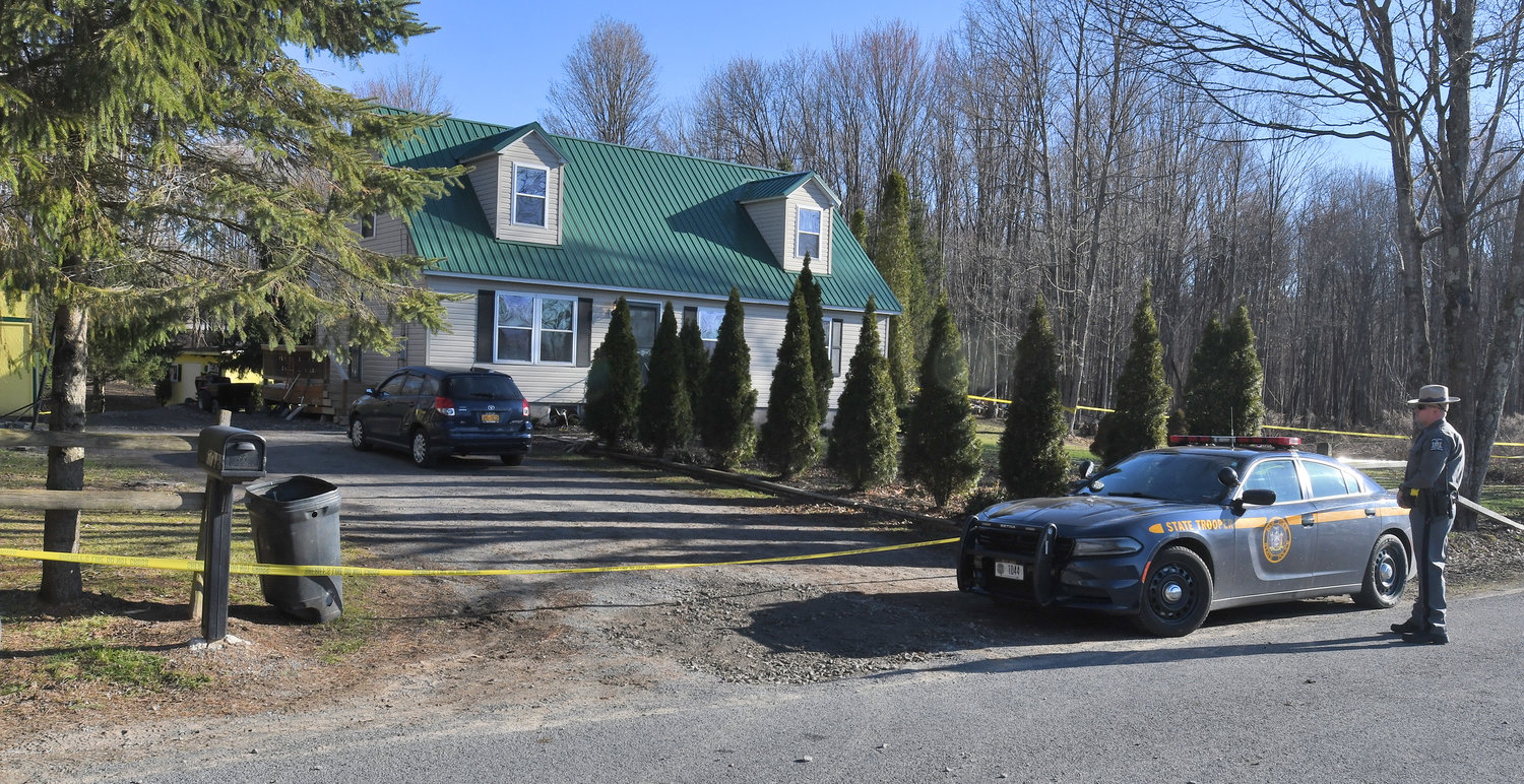 SHOOTING UNDER INVESTIGATION — A state trooper stands guard in front of the residence on Golly Road in the Town of Lee where a state trooper was forced to shooting a man Tuesday night. State police are expected to release more information on the incident today.