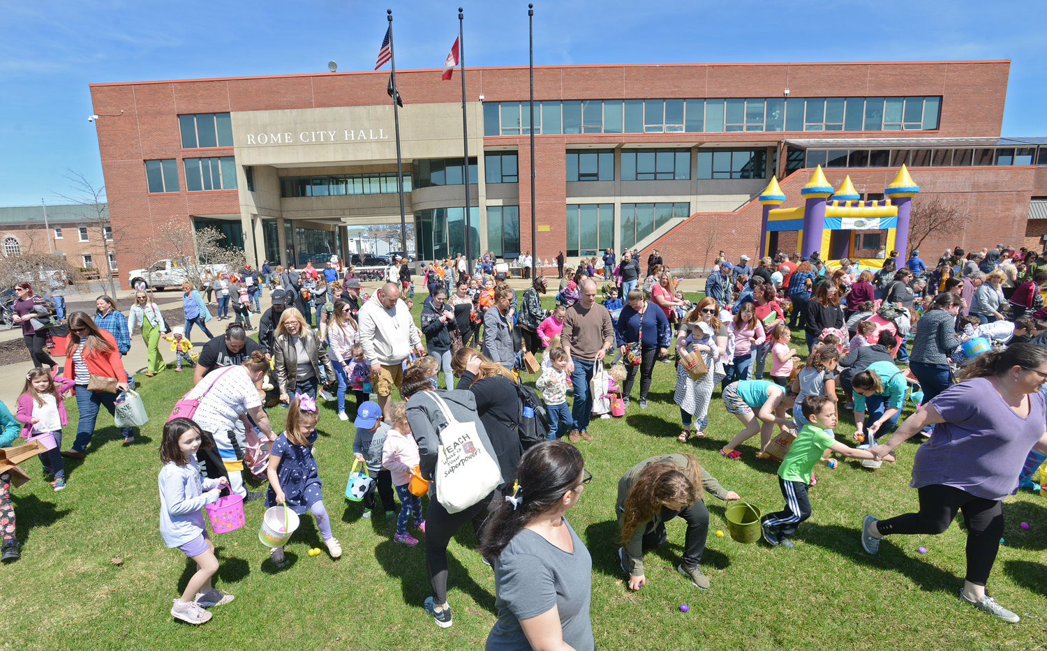 SCRAMBLE — Kids and families scrambled to hunt for eggs on the Griffo Green at the City Hall Easter Egg Hunt on Wednesday afternoon. Some 4,000 eggs were hidden throughout the green and surrounding area. More photos of the event on page 2.