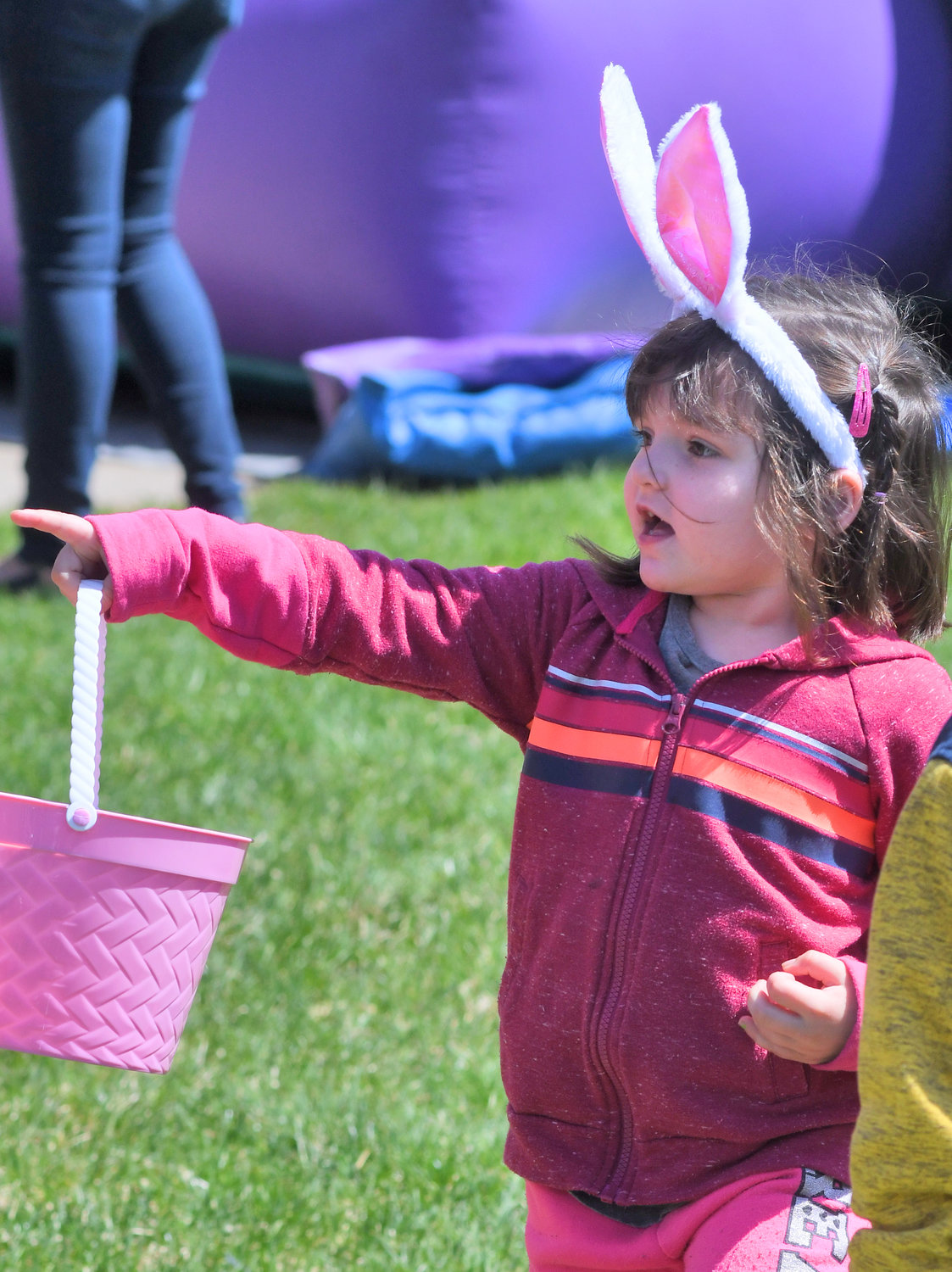 THERE HE IS — Saige Goodhines, 4, points to the Easter Bunny at City Hall on Wednesday afternoon. Saige was at the Easter Egg Hunt with her brother Wyatt Goodhines, 5, and mother Misty Goodhines.