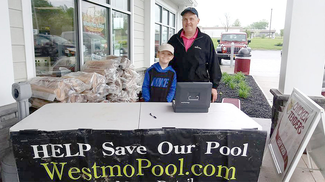 RAISING MONEY — Westmoreland Summer Activities Association president Scott Tarkowski with his son Ryan selling raffle tickets to raise money for the pool.