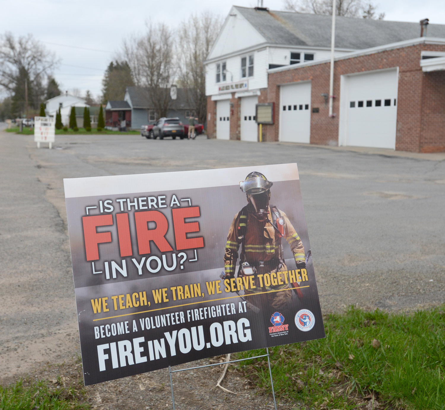 RECRUITNY — A sign in front of the Lake Delta firehouse on Elmer Hill Road seeks to entice new volunteers. Lake Delta is one of nearly two dozen fire departments across the county holding an open house this weekend as part of the RecruitNY effort.