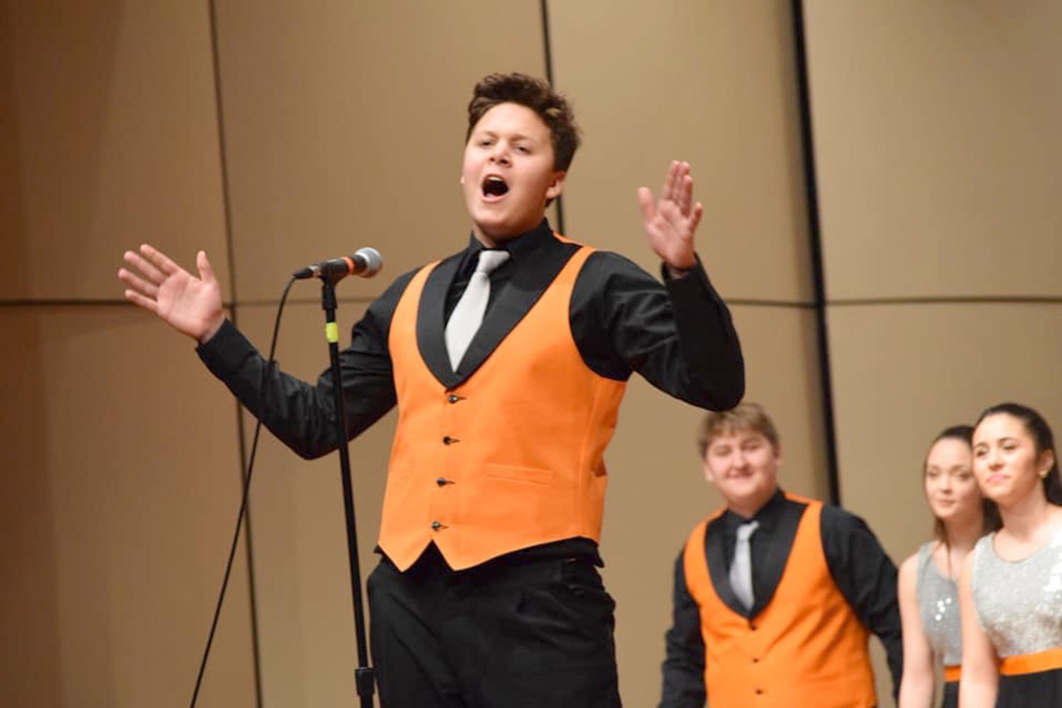 EXPRESSIVE SONG — David Salce, a vocalist in Rome Free Academy's Rhapsody Show Choir, is shown during a recent performance. Rhapsody will host a performance tonight with the Rome Community Theatre Talent Team and the Denti Elementary Drama Club at the RFA auditorium. It begins at 7 p.m.