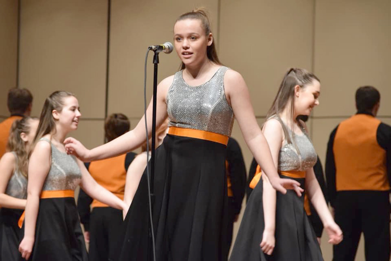 VOCAL FOCUS — Kayla Bush, a vocalist in Rome Free Academy's Rhapsody Show Choir, is shown during a recent performance. Rhapsody will host a performance tonight with the Rome Community Theatre Talent Team and the Denti Elementary Drama Club at the RFA auditorium. It begins at 7 p.m.