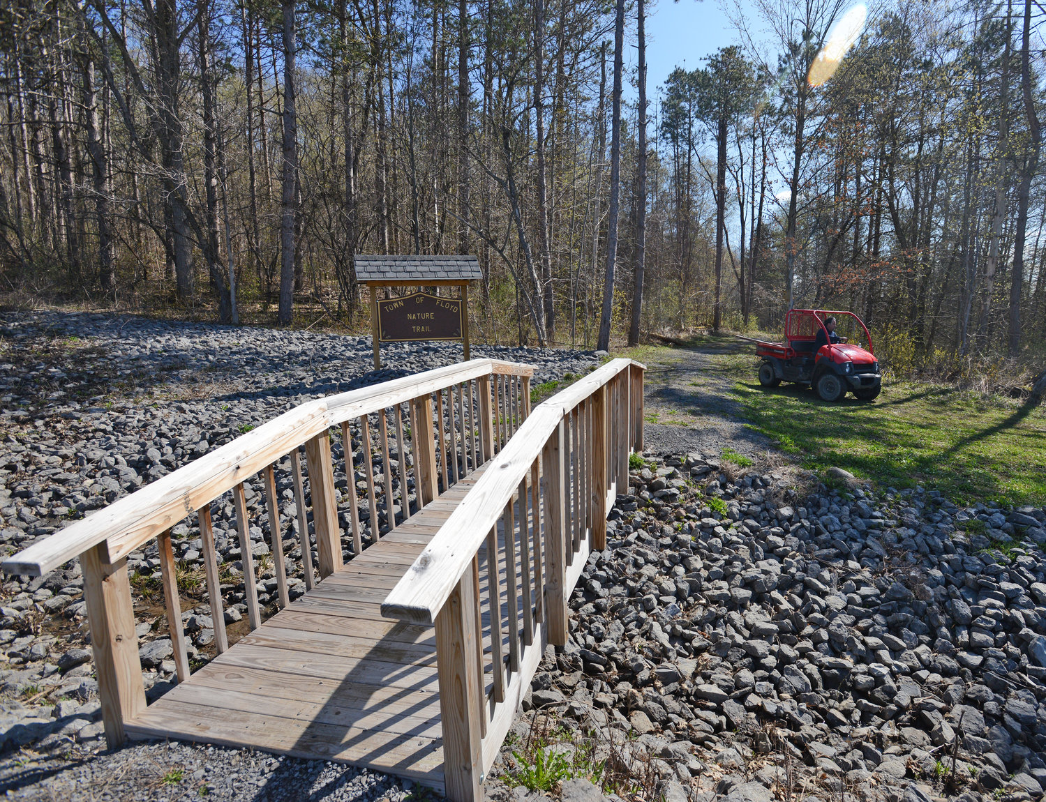 PATH LESS TAKEN — A new foot bridge is installed at the entrance of the new Nature Trail in the Town of Floyd off Camroden Road. The trail is part of a major project in the town that includes park improvements, tree plantings and a new storage structure for road salt and sand.