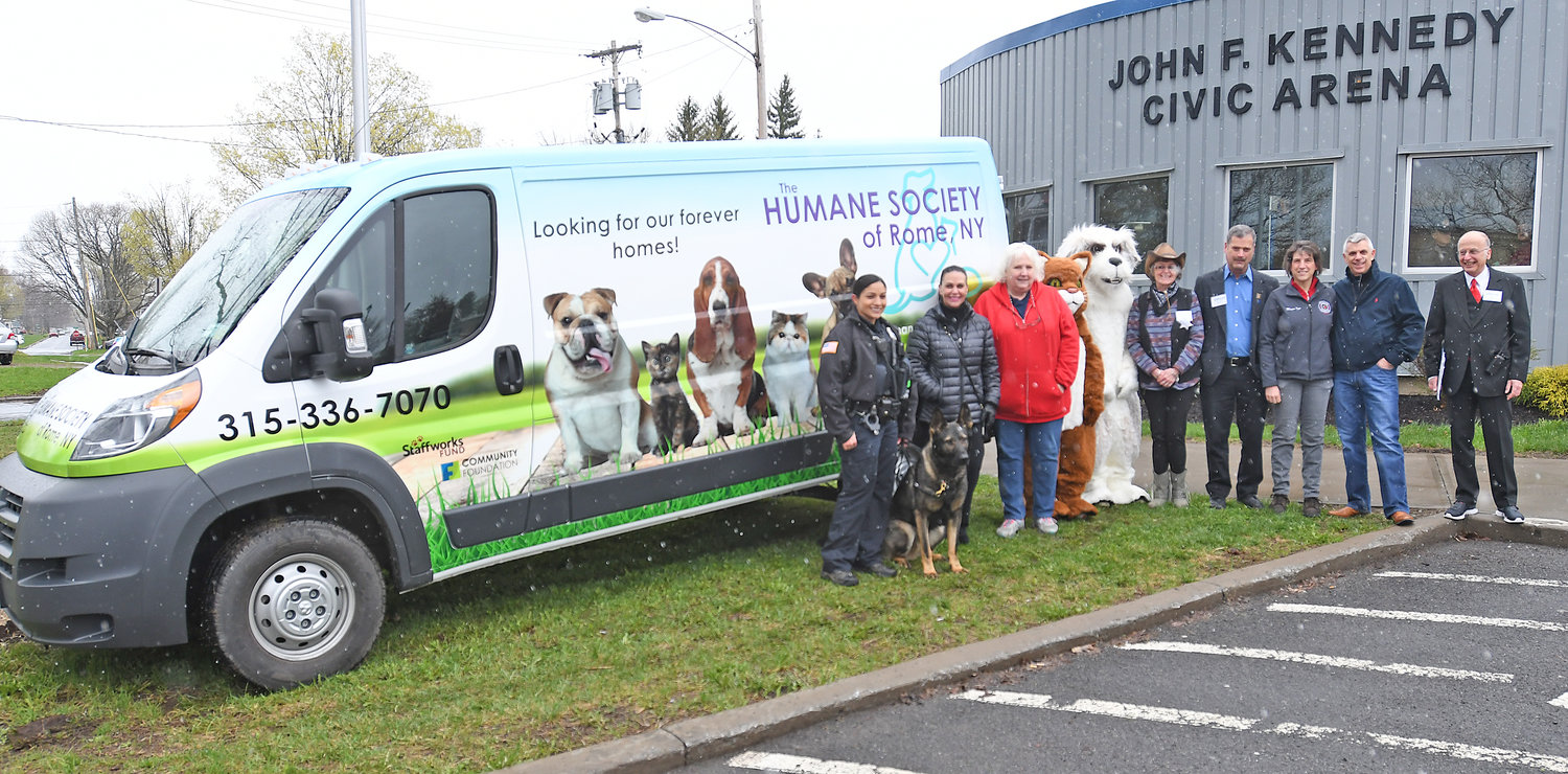 NEW VAN — The new Humane Society of Rome van was unveiled at the Rome Home Expo on Saturday. Among those celebrating the new van, from left: Patrolman Alexzandra Carletta and K-9 officer Arko; Lynn Rosen, humane society president; Sara Tuthill, humane society bookkeeper; Helene Rudiak, shelter manager, Elliot Friedman, of the Rome Chamber of Commerce; Mayor Jacqueline M. Izzo; Oneida County Executive Anthony J. Picente Jr., and Bill Guglielmo, president of the Rome Area Chamber of Commerce.