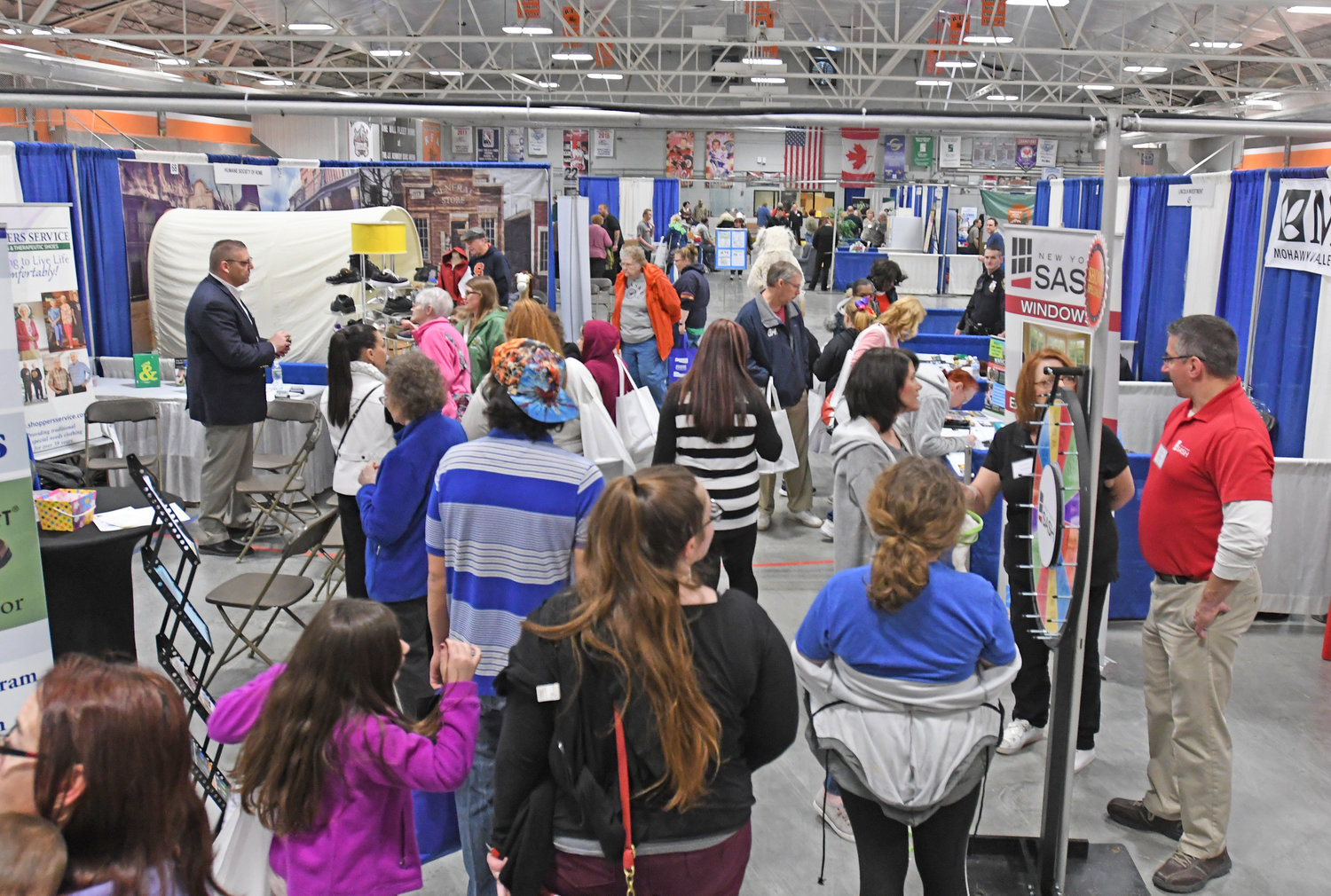 TAKING IT ALL IN — Visitors walk through the different booths on the vendor floor at the Rome Home EXPO held Saturday and Sunday at the J.F. Kennedy Civic Arena, 500 W. Embargo St.