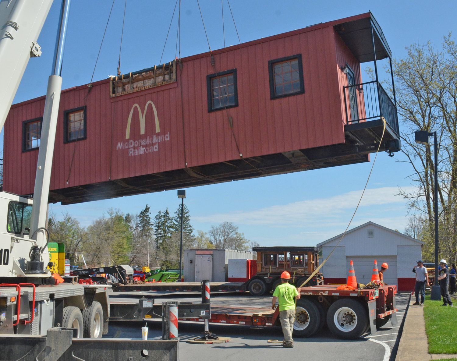 CABOOSE IS LOOSE — This red caboose known to many Clintonians from the drive-thru lane at the Meadow Street McDonalds pulled out of the fast food station for the last time on Tuesday, April 23 on its way to a new home in St. Johnsville. The new owners of the 30-year-old conversation piece plan on make it an 1860s era cabin for rent in their recreation trailer park.