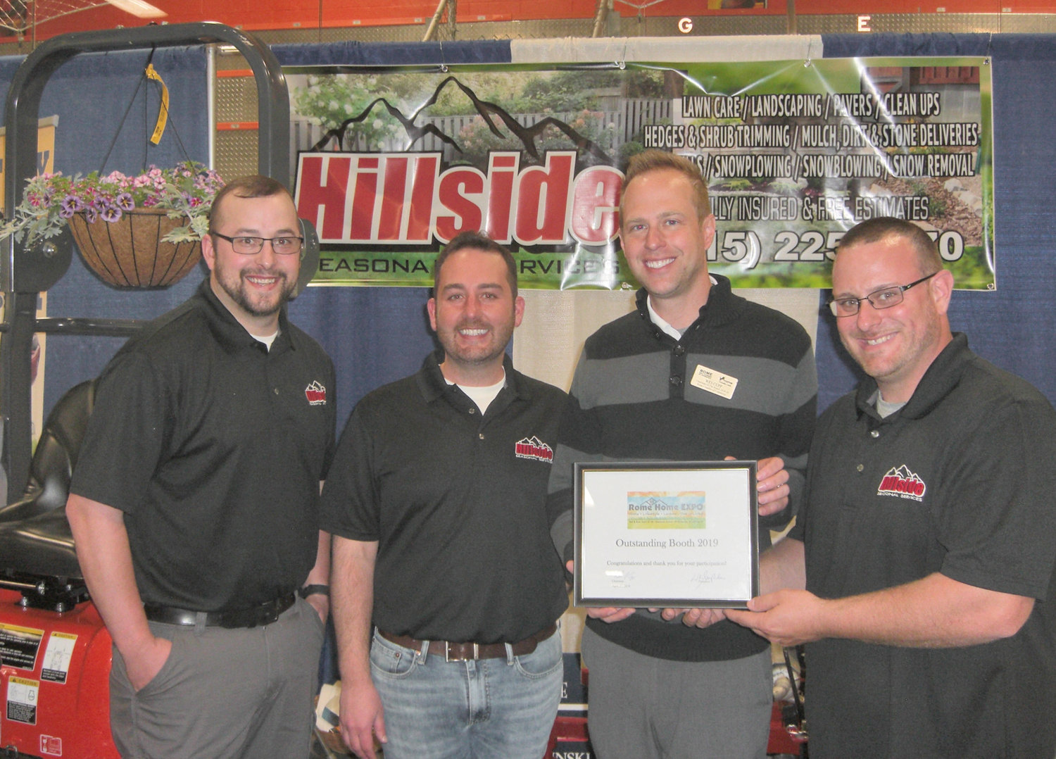 HILLSIDE RECOGNIZED — HIllside Seasonal Services was recognized as having an outstanding booth at the Rome Home Expo last weekend. From left to right: Nick Britton, landscape designer; Chris Palinski, co-owner; Wes Cupp, Rome Chamber Board Chairman; Eric Tyler, co-owner. According to Rome Home EXPO event organizers, the annual event drew more than 1,200 visitors to the J.F. Kennedy Civic Area.