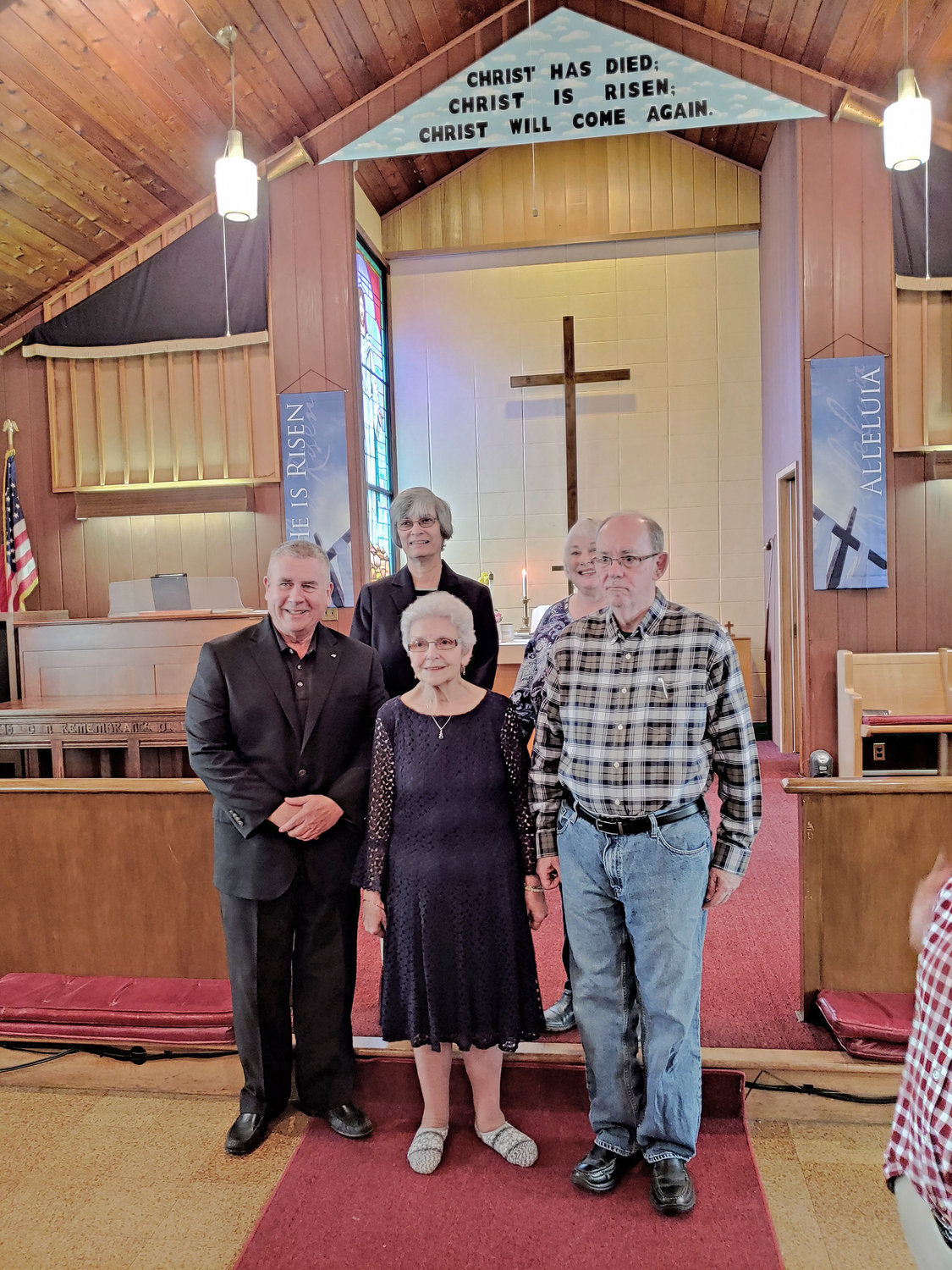 PASTORS' APPRECIATION — Molly Pritchard, in front at center, stands amid some of the pastors with whom she has worked as Delta United Methodist Church's music director and organist; she is retiring. From left: Rev. Robert Wollaber; Rev. Patricia Hubman (in back); Rev. Susan Walters (in back); Rev. Arthur Miner.