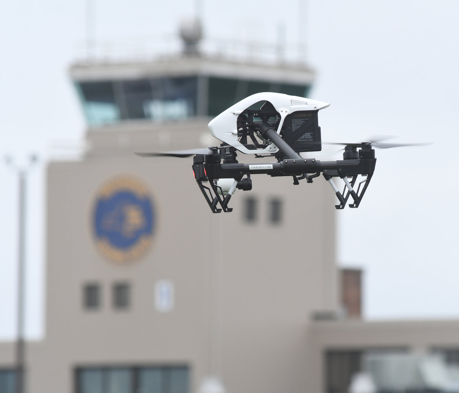 BUZZING THE TOWER — A training drone hovers above the ground at the state Preparedness Training Center in Whitestown on Thursday. A dozen officials from across the state attended a basic drone operator training course this week at the former county airport.