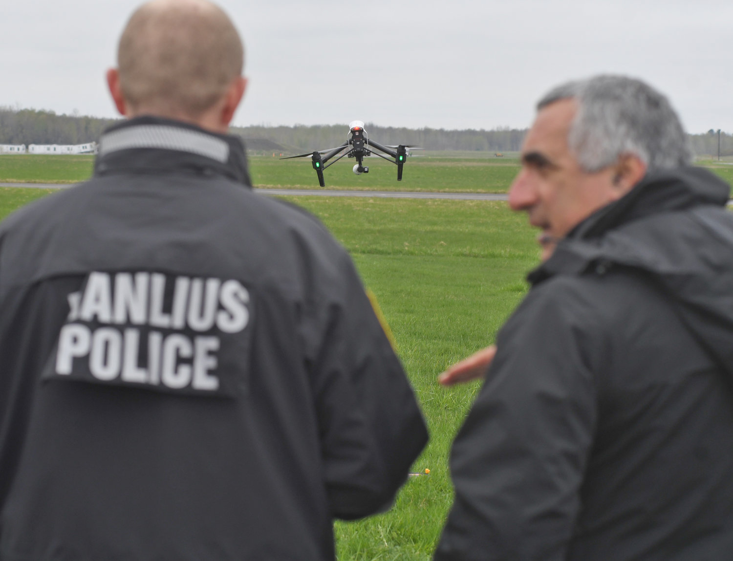 STUDENT AND TEACHER — Sgt. Greg Snyder with the Manlius Police Department, left, tries his hand at operating a training drone at the state Preparedness Training Center on Thursday. He is instructed by Gary McPherson, one of the trainers from the state Department of Environmental Conservation.