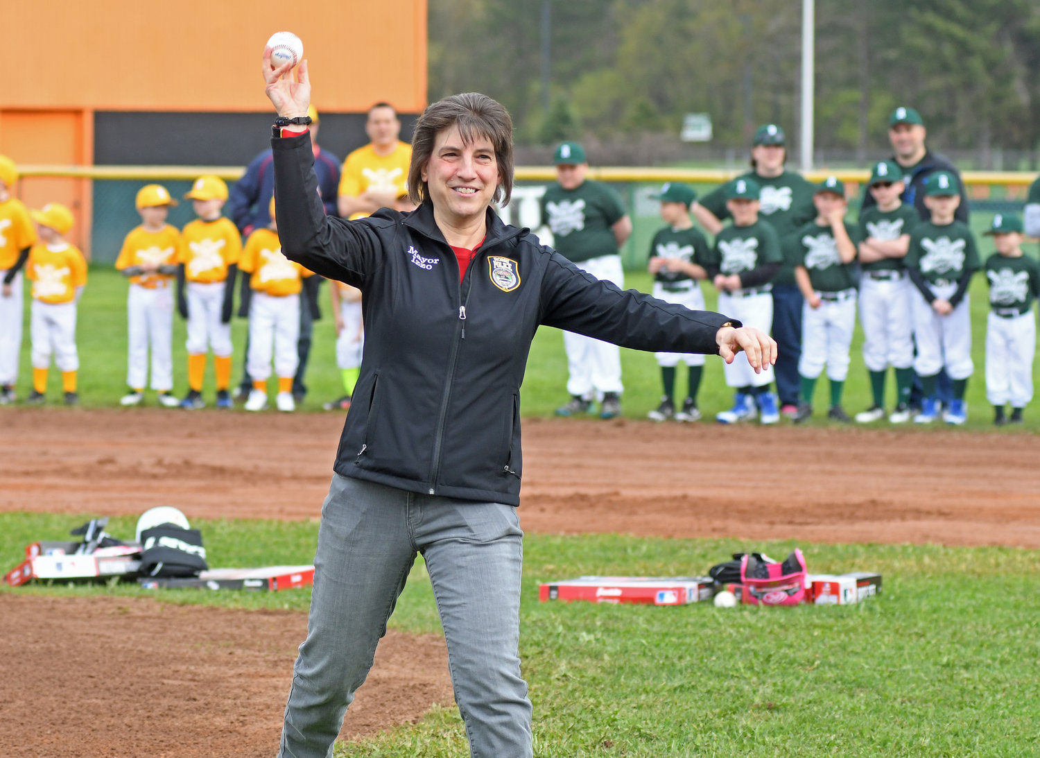 Mayor Jacqueline M. Izzo throws out one of the first pitches.