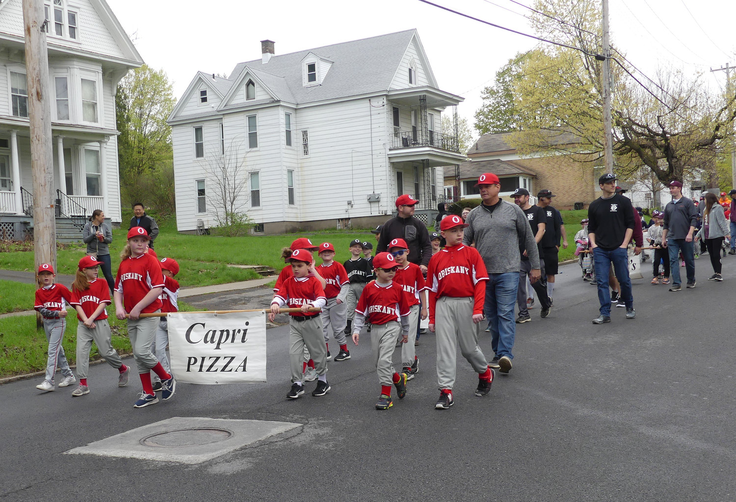Capri Pizza marches during opening day ceremony parade in Oriskany on Utica St.