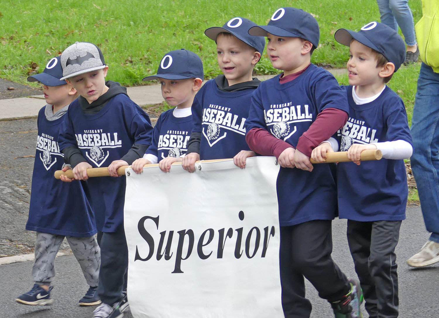 Oriskany little league t-ball team from Superior march during opening ceremony parade on Saturday.