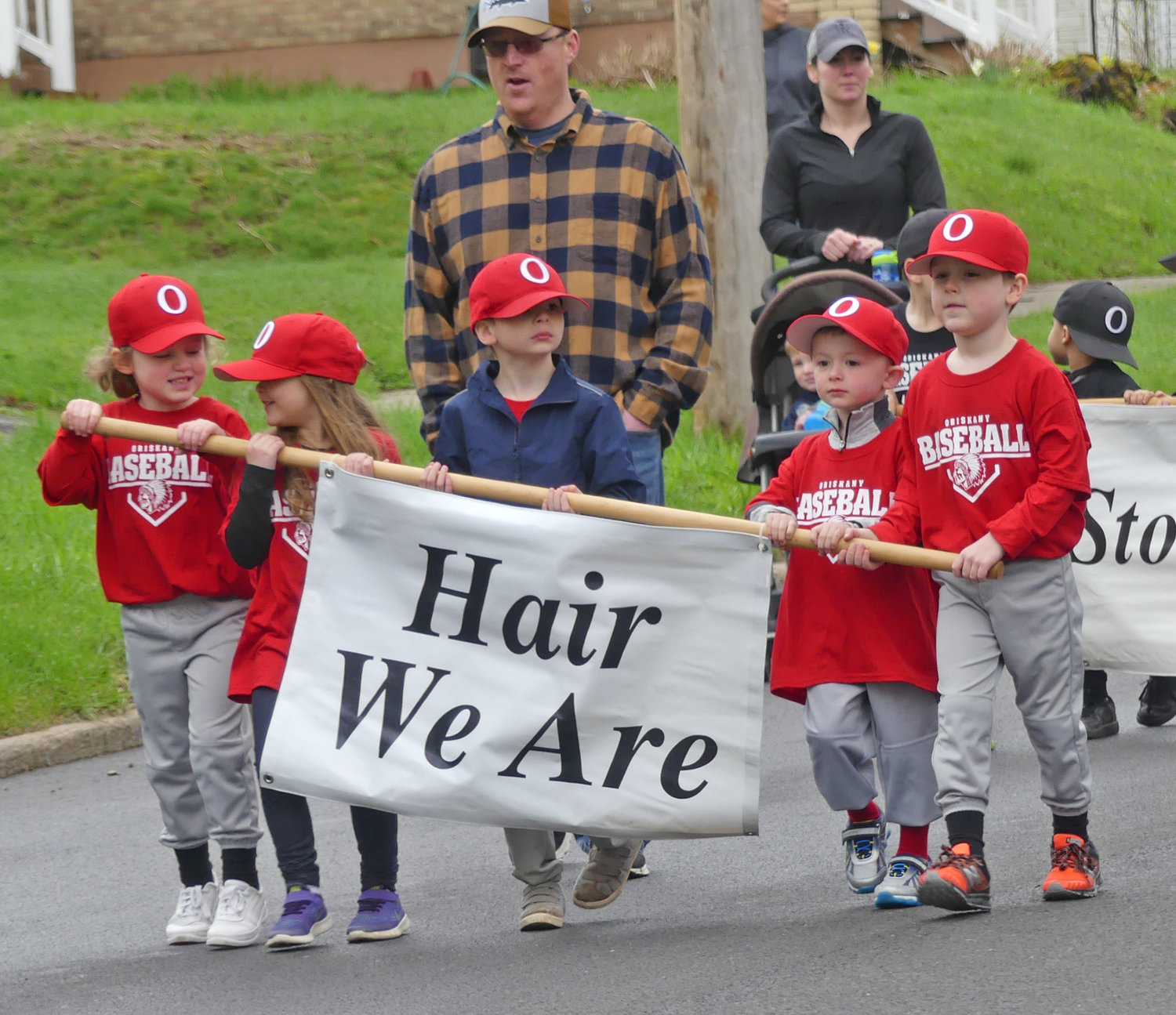 Hair We Are t-ball team marches during opening day ceremony in Oriskany on Utica Street.