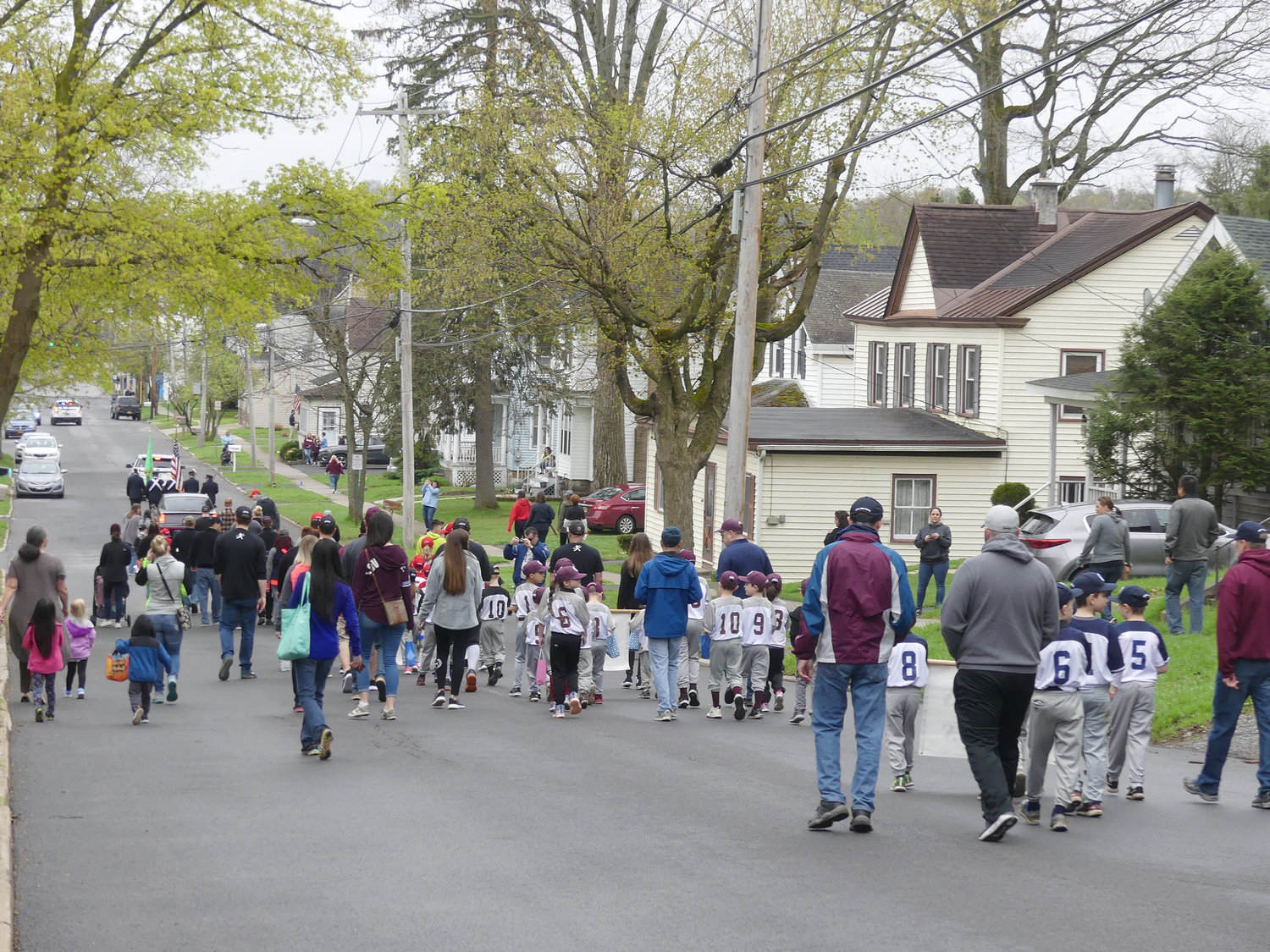 Oriskany little leaguers march during opening ceremony parade on Saturday on Utica St..