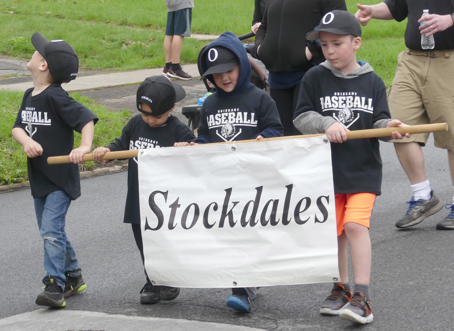 Stockdales t-ball team members march during Saturdays opening day parade in Oriskany.