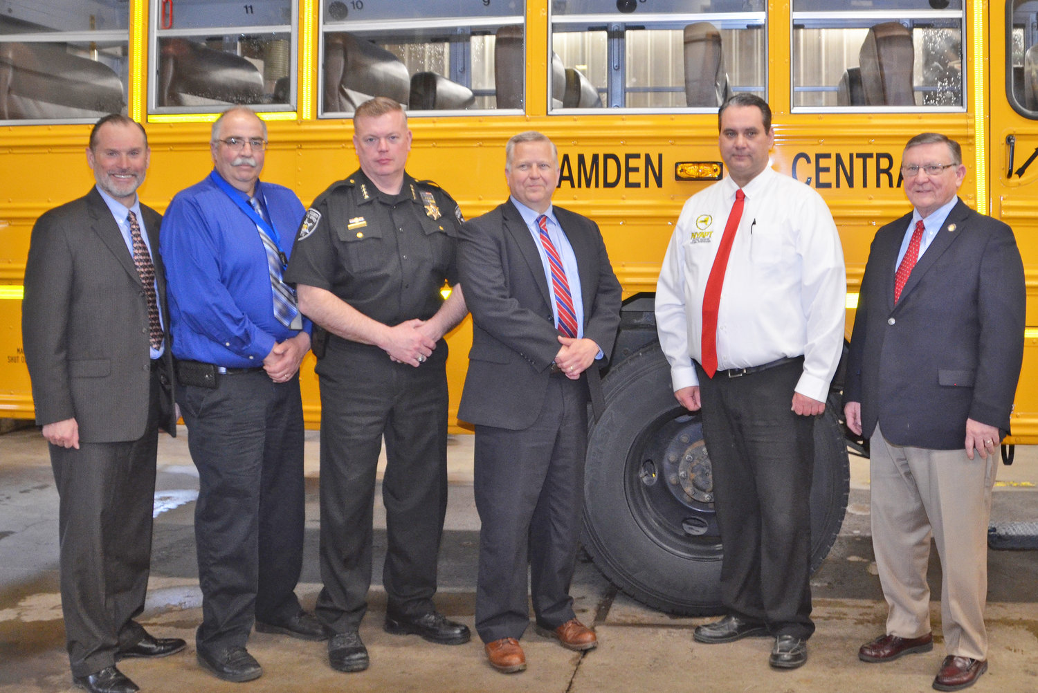 OPERATION SAFE STOP EVENT — Among those attending an event hosted by the Camden school district in conjunction with Operation Safe Stop for bus safety, from left: Camden district Assistant Superintendent for Business Karl Keil Jr.; Camden district Transportation Director Ed Snow; Oneida County Sheriff Robert Maciol; Camden district Superintendent Ravo Root; New York Association for Pupil Transportation President Michael Sweeney, who also is transportation director for the Westmoreland school district; Assemblyman Kenneth Blankenbush, R-117.