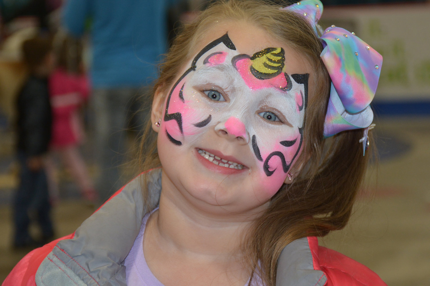 SAY CHEESE! — Face painting makes the circus more fun and there are a lot of different characters to choose from. This little kitten is 6-year-old Isabella Bower of New Hartford and her mom and her were having all the fun they could stand during the Garden Brothers Circus.