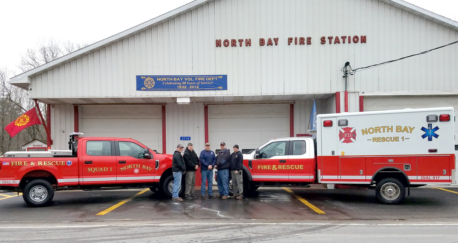 NORTH BAY TRUCKS — North Bay firefighters show off their two new service trucks. On the left is a 2018 F-350 pickup to be used for transport. On the right is a 2019 F-450 cab, attached to a refurbished rescue body with both Basic and Advanced Life Support systems. Firefighters from left: 2nd Deputy Chief Wayne Matthews; 1st Deputy Chief Bill Shaughnessy Jr.; Chief Joseph Matthews; Assistant Chief Ryan Trudell; and Assistant Chief Andy Skinner.