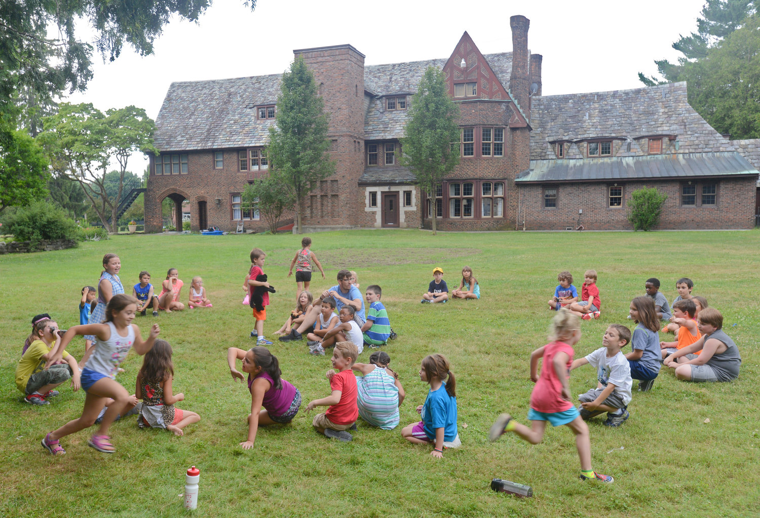 SUMMER CAMP — Participants in the Artletics Summer Camp program at the Rome Art & Community Center have some fun in the sun last year playing Duck Duck Goose.