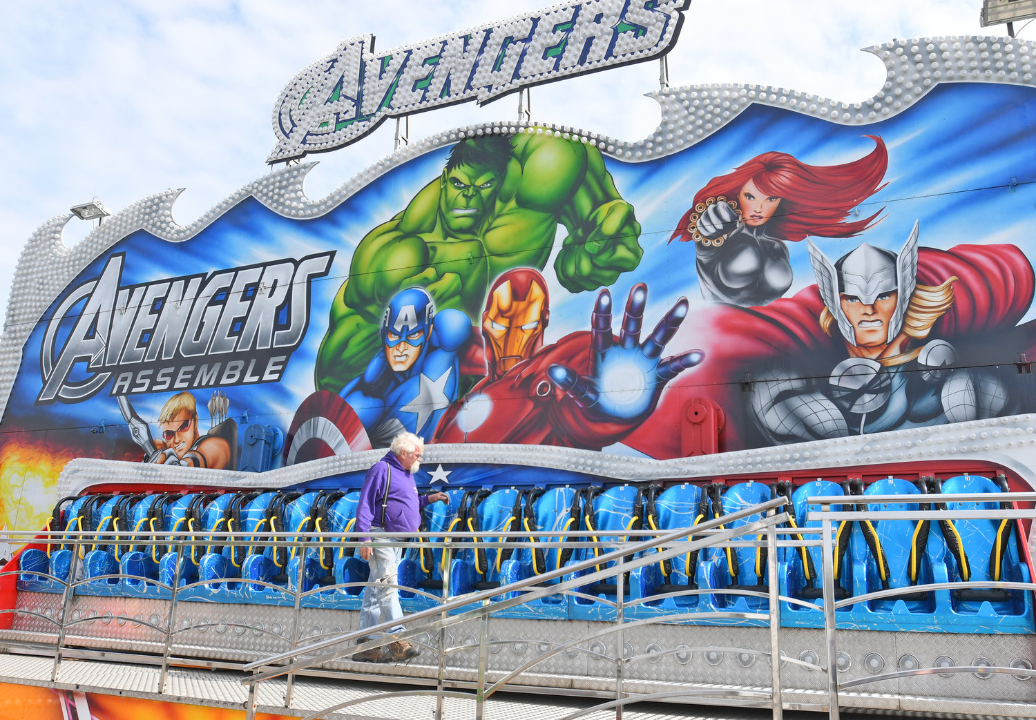 READY FOR RCS FESTIVAL — Scott Gardner, ride supervisor for the Main Event Amusements company of Camillus, looks over the Avengers ride that has been set up among various activities for the Rome Catholic School Spring Festival fundraiser this weekend. The festival will be at the former RCS grounds.