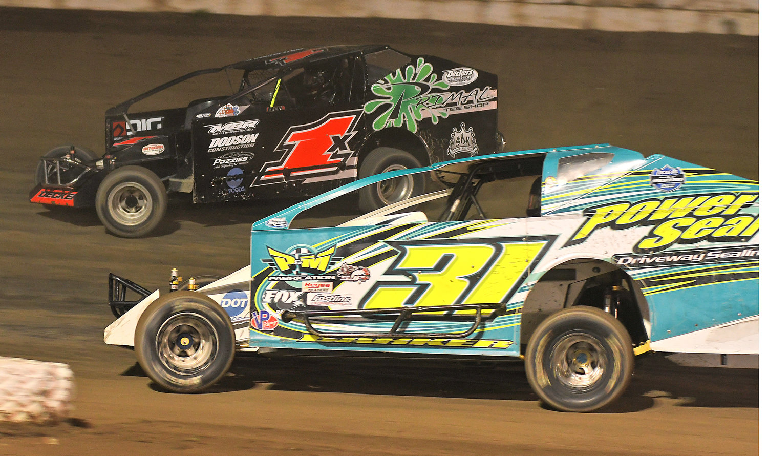 GOING FORWARD — Willy Decker Jr., No. 1x, and Corey Barker, No. 31, race in turn two at Fulton Speedway last Saturday night. Decker's finish of fourth doesn't reflect the great run he had, but the strong performance has the Vernon driver looking forward to the new season.
