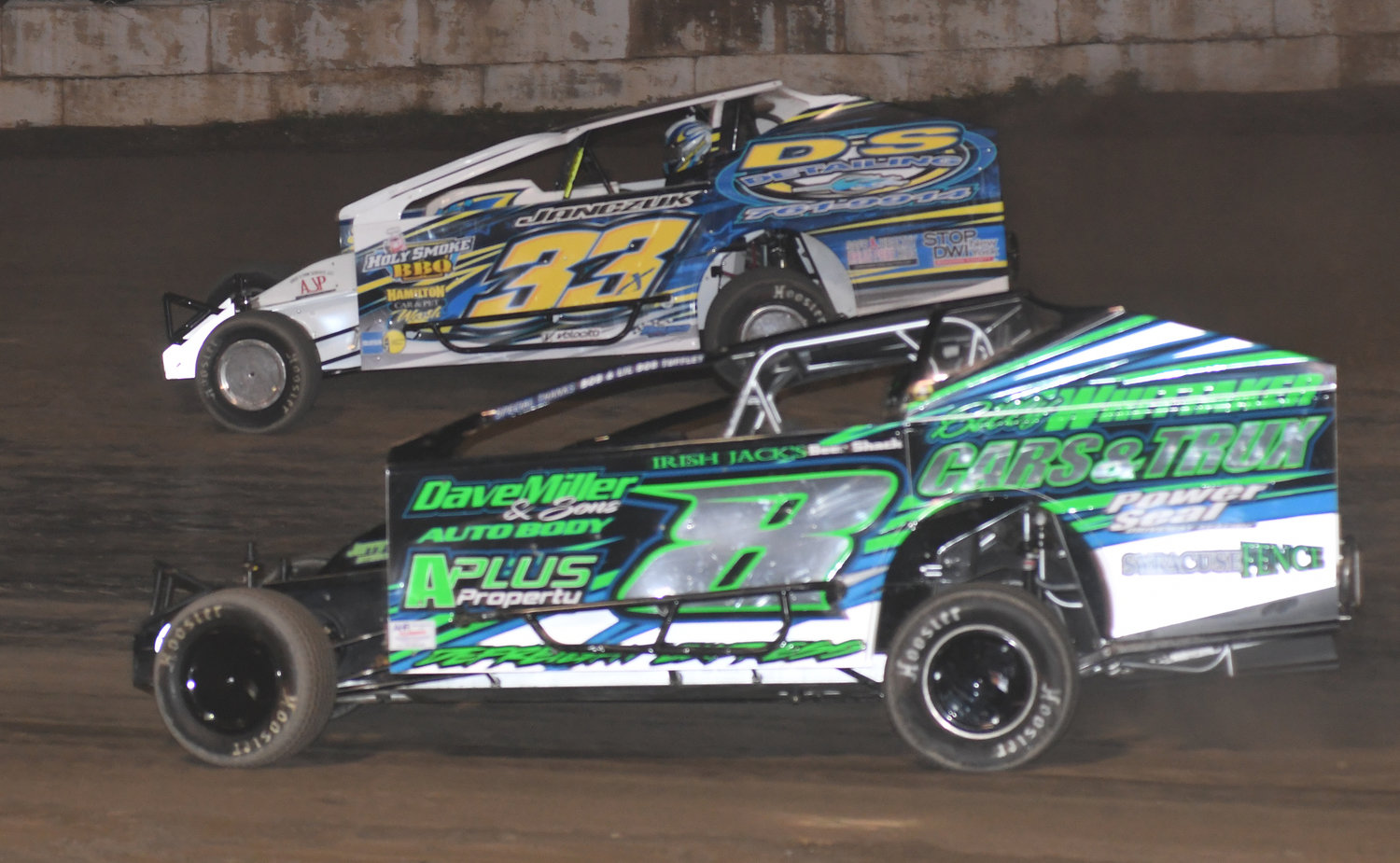 HIGH SIDE — Durhamville's Matt Janczuk, 33x, finds the fast way around Fulton Speedway last Saturday night by choosing the high side. Janczuk went on to win the feature with Alan Fink, 8, coming home second.