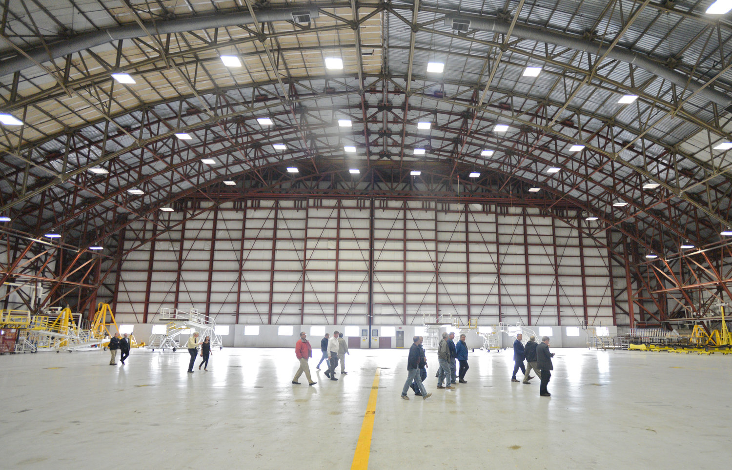 HANGAR TOUR — Oneida County legislators walk through one of the giant hangars that 747's can fit in at building 101 at Griffiss International Airport.
