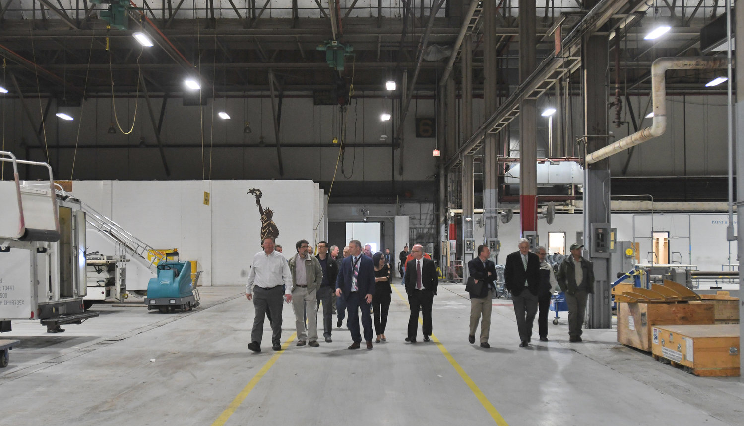 ON TOUR — Oneida County legislators walk through the core of building 101 on Tuesday evening at Griffiss International Airport. The county is taking legal ownership of the former Air Force hangar with plans to reduce utility costs and leasing the space to tenants, perhaps in the aircraft maintenance industry.