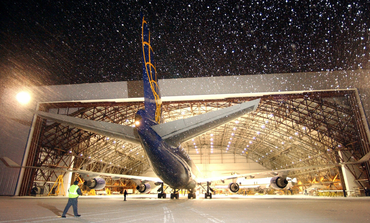 ROOM TO WORK — A Atlas Air 747 is pulled into a hangar at Empire Aero Center Monday, January 19, 2004 in this file photo. Oneida County officials and lawmakers hope to update utilities in the building to make its use economical for prospective tenants in the aviation industry. (Sentinel photo by John Clifford)