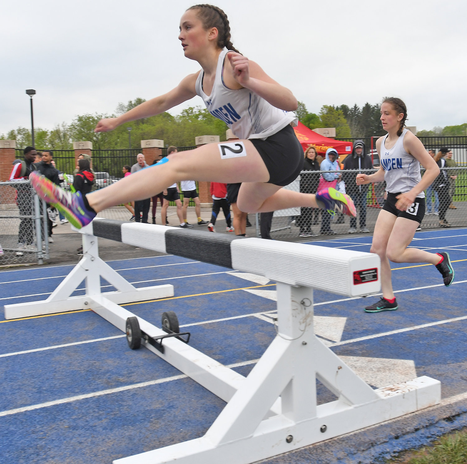 CAMDEN RACERS — Catherine Seidl, left, and Morgan Lucason of Camden compete in the steeplechase at the Oneida Invitational Friday. Seidl and Lucason, both juniors, finished second and third, respectively.