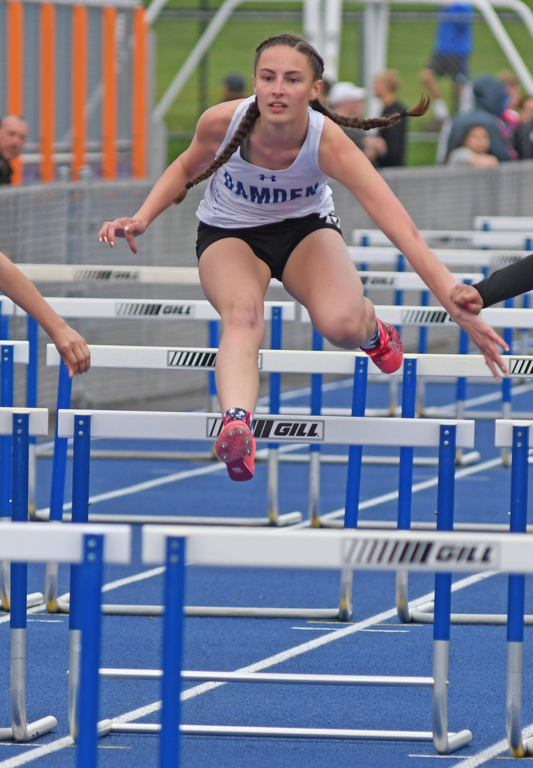 IN THE RACE — Camden junior Mary Buckingham in the 100-meter hurdles at the Oneida Invitational Friday. She finished in ninth place.