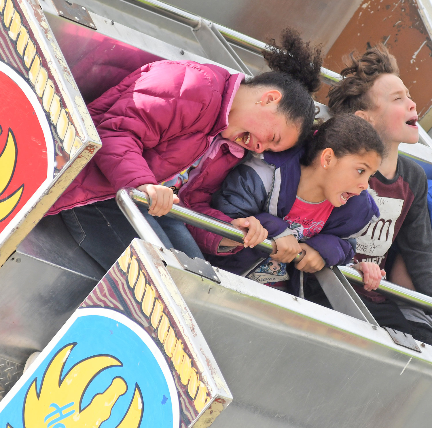 HAVING A FIELD DAY — Sisters Ayriana Henderson, 9, and Briana Henderson, 5, ride Captain Kat's Sea Ray at the Rome Catholic School Festival on Saturday afternoon. The festival is a major fundraiser for the school, Principal Nancy Wilson has said.